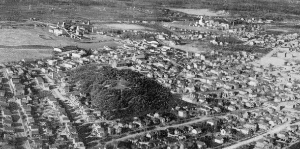 A tough town built solely on mining: houses, headframes and miles of hard rock. Kirkland Lake in the thirties. (Museum of Northern History)