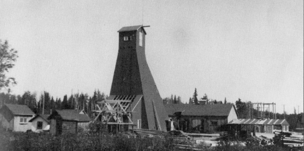 The Macassa Mine, still in operation, was the last of the seven mines to be constructed on the Mile of Gold. This 1932 view shows the first headframe. (Museum of Northern History)